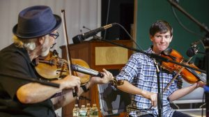 Master fiddle student Alexander Alison performs with Cajun fiddler David Greely at the 2017 Acadia Trad Festival